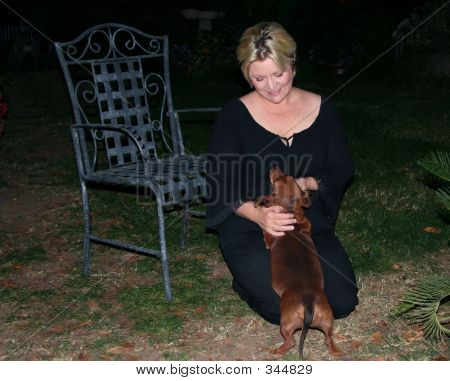 Lady And Her Dachsund Dog