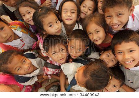 SAYABOURY - FEBRUARY 16: group of joyful unidentified kids posing during the Elefantasia festival on February 16, 2012 in Sayaboury, Laos