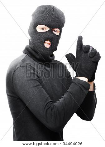 Male Criminal In Mask Making A Hand Gun Gesture