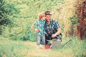 Dad Teaching Little Son Care Plants. Little Helper In Garden. Planting Flowers. Growing Plants. Fres poster