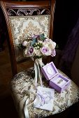 Brides Wedding Bouquet On The Arm Chair. Wedding Decoration, Wedding Bouquets Of Purple And White Fl poster