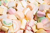 A Large Pile Of Sweet Air Marshmallows In A Supermarket. Marshmallow In The Form Of Slices Of Waterm poster