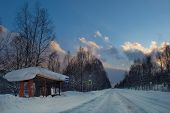 Russia. South Of Western Siberia. Picturesque Cold Sunset On A Snow-covered Road In The Mountain Sho poster