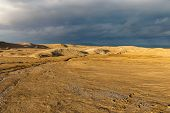 Mud Volcanoes Of Gobustan, Azerbaijan, View Of Volcanoes Against A Stormy Sky poster
