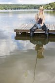 pic of fisherwomen  - fishing woman sitting on pier - JPG