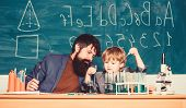 Father And Son At School. Back To School. Using Microscope In Lab. Student Doing Science Experiments poster