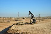 stock photo of water shortage  - An oil well pumps crude out of the Kern County  - JPG