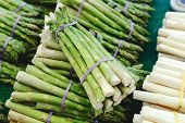 Bunches Of Fresh Raw Green Organic Asparagus Vegetables For Sale At Farmers Market. Vegan Food Conce poster