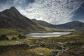 Majestic Sky Over Landscape Of Tryfan And Llyn Ogwen In Snowdonia Wales poster