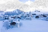 Panoramic View Of Scenic Winter Landscape In Swiss Alps With Famous Church In The Center Of The Vill poster