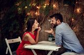 Romantic date.Happy man and woman spending time together on a romantic date. poster