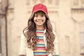 This Girl Is Hipster. Happy Little Hipster With Long Curly Hair Wearing Baseball Cap Outdoor. Cute S poster