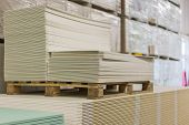 Materials For Repair In A Hardware Store. Repair And Construction Concept. Drywall Racks In A Hardwa poster
