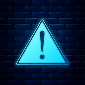 Glowing Neon Exclamation Mark In Triangle Icon Isolated On Brick Wall Background. Hazard Warning Sig poster