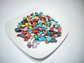 Colored Candy On The Plate. Multi-colored Stones Candy On The Plate, Colorful Stone Texture Backgrou poster