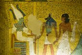 image of hieroglyphs  - The King of the Underworld - Osiris is presented with the noble Irynefer by Anubis, god of mummification. Wall painting in the Ancient Egyptian tomb of Irynefer at Deir el Medina near Luxor, Egypt.