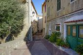 1_ One Of The Many Colourful And Quiet Streets In Antibes, France. poster