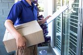 Delivery Man Deliver Box Parcel Package And Clipboard Documents Sending To Customer In Front Of The  poster