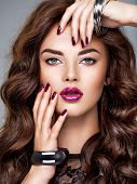 Trendy fashion portrait of woman. Beautiful and stunning woman with purple lipstick on lips and fing poster