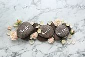 Stones With Words Mind, Body, Soul And Rose Flowers On Marble Background, Flat Lay. Zen Lifestyle poster