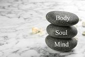 Stones With Words Mind, Body, Soul On Marble Background, Space For Text. Zen Lifestyle poster