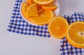 Fresh Oranges Sliced On Table. Still Life Of Ripe Healthy Fruit. Sliced Juicy Citrus Fruits Backgrou poster