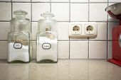 Nostalgic Still Life Of Retro Kitchen With Two Jars Salt And Sugar On The Counter, Selective Focus O poster