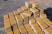 New Yellow Paving Slabs Piled In A Pile One On Top Of Another On A Sunny Day, Close Up. poster