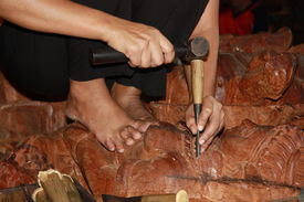 picture of woodcarving  - Hands of a master woodcarving buddhist sculpture for a temple - JPG