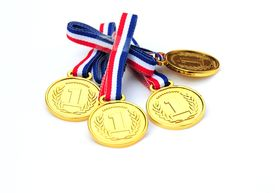 picture of gold medal  - shot of some gold medals on white - JPG