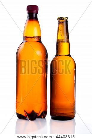 Isolated Brown Plastic Bottle And Glass Bottle Of Beer On A White Background