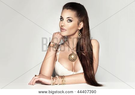 Beautiful Brunette Woman Wearing A Lot Of Jewelry.