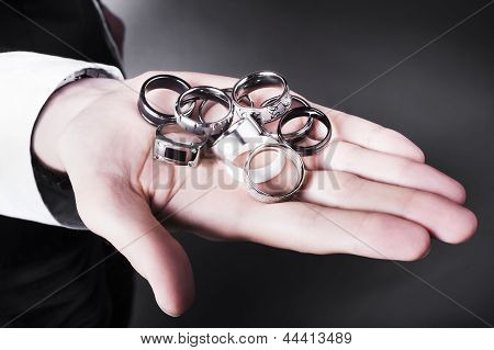 Man Displaying A Selection Of Stylish Rings