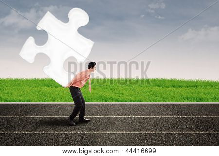 Asian Man Carry Puzzle On The Road