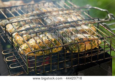 Marinated white fish on the grill