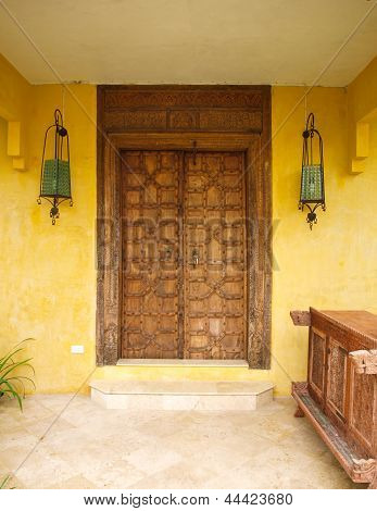 Antique Moroccan Style Wooden Door  On Yellow Wall