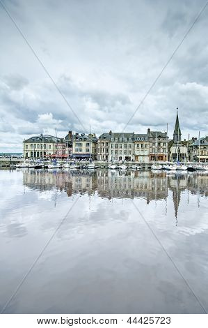 Honfleur Skyline And Harbor With Reflection. Normandy, France