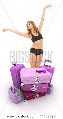 A pile of luggage and a female dancer mimicking a flight