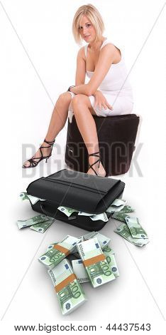 Young woman with a suitcase full of hundred euro bills