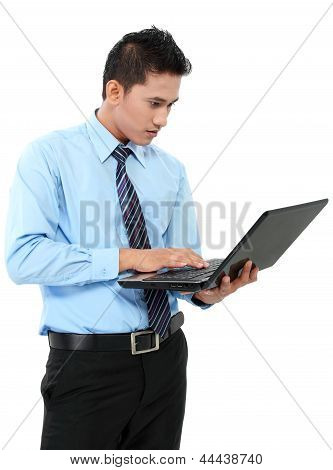 Confident Businessman With Laptop