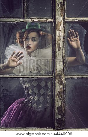 A Lonely Pierrot Woman Behind The Glass