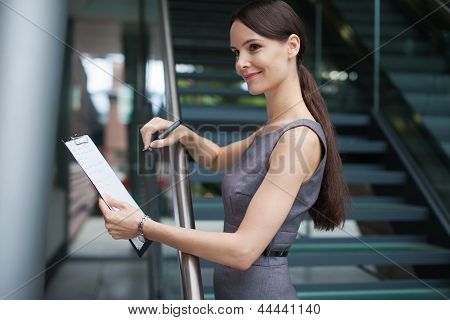 Beautiful Business Woman Taking Notes