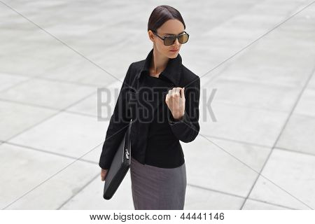 Beautiful Young Business Woman Is Wearing Sunglasses