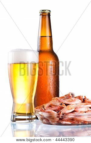Brown Bottle Of Beer With A Condensate, Glass And Plate Of Boiled Shrimp On Isolated White Backgroun