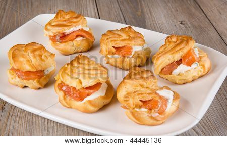 Eclairs And Profiteroles Filled With Cream And Salmon