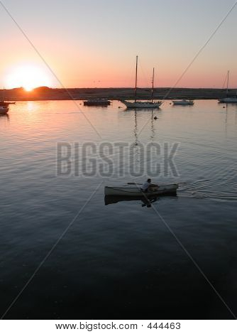 Canoe And Sailboats On The Bay