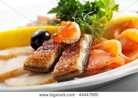 Fish Dish with Lemon, Parsley Leaf and Olives