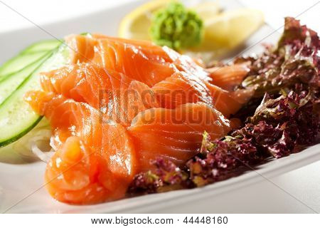 Salmon Sashimi - Sliced Raw Salmon on Daikon (White Radish) with Seaweed and Cucumber