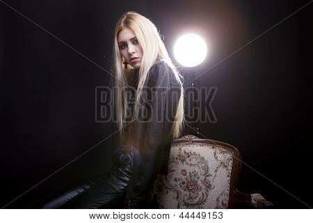 Beautiful Sexy Girl In Leather Jaket On A Vintage Chair