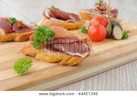 Slices Of Bread With Spanish Serrano Hamon
